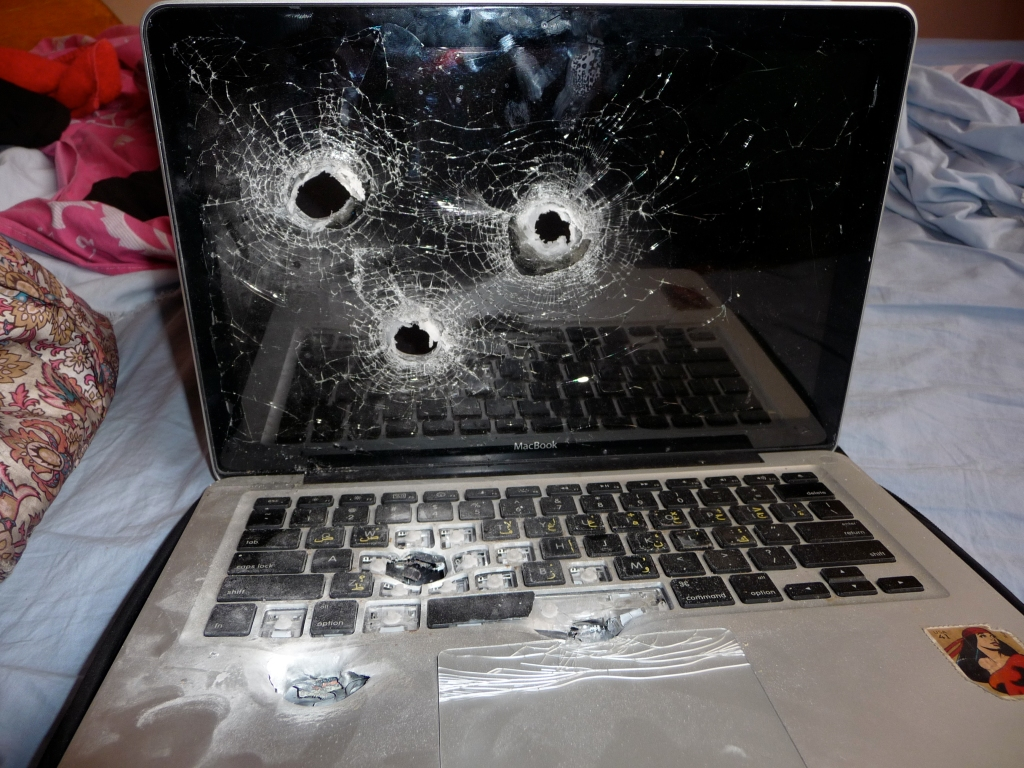 Lilly Sussman's laptop - three bullets through